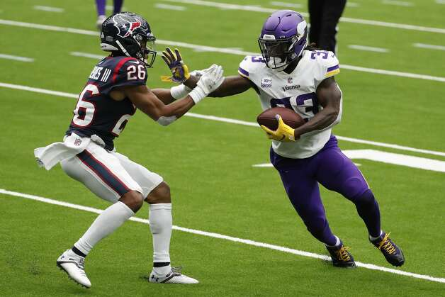 Minnesota Vikings running back Dalvin Cook (33) goes up against Houston Texans cornerback Vernon Hargreaves III (26) as he breaks away from theTexans defense on his way to a 7-yard touchdown run during the first half of an NFL football game at NRG Stadium on Sunday, Oct. 4, 2020, in Houston. Photo: Brett Coomer/Staff Photographer / © 2020 Houston Chronicle
