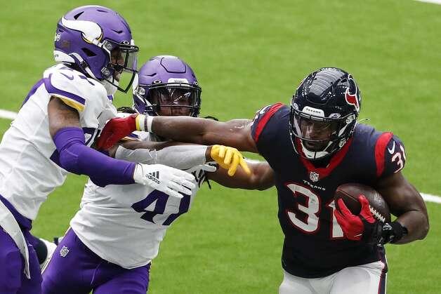 Houston Texans running back David Johnson (31) is pushed out of bounds by Minnesota Vikings cornerback Cameron Dantzler (27) and free safety Anthony Harris (41) during the third quarter of an NFL football game at NRG Stadium on Sunday, Oct. 4, 2020, in Houston. Photo: Brett Coomer/Staff Photographer / © 2020 Houston Chronicle