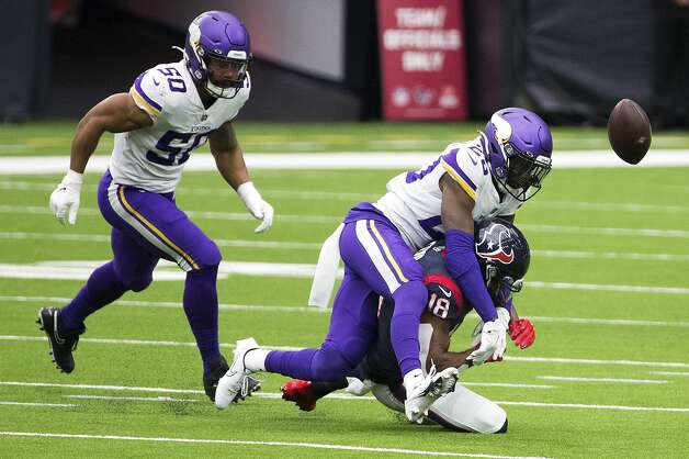 Minnesota Vikings cornerback Jeff Gladney (20) breaks up a pass intended for Houston Texans wide receiver Randall Cobb (18) during the first half of an NFL football game at NRG Stadium on Sunday, Oct. 4, 2020, in Houston. Photo: Brett Coomer/Staff Photographer / © 2020 Houston Chronicle