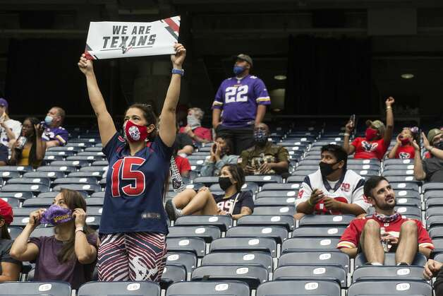 Houston Texans fans cheers as they are seated socially distanced during the first half of an NFL football game against the Minnesota Vikings at NRG Stadium on Sunday, Oct. 4, 2020, in Houston. As many as 13,300 fans were allowed into the stadium for the first time this season. Photo: Brett Coomer/Staff Photographer / © 2020 Houston Chronicle