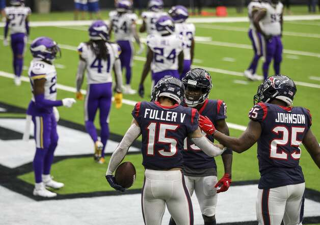 Houston Texans wide receiver Will Fuller (15) is congratulated by wide receiver Brandin Cooks (13) and running back Duke Johnson (25) after he caught a pass that was later ruled to be incomplete during the fourth quarter of an NFL game on Sunday, Oct. 4 2020, at NRG Stadium in Houston. Photo: Jon Shapley/Staff Photographer / © 2020 Houston Chronicle