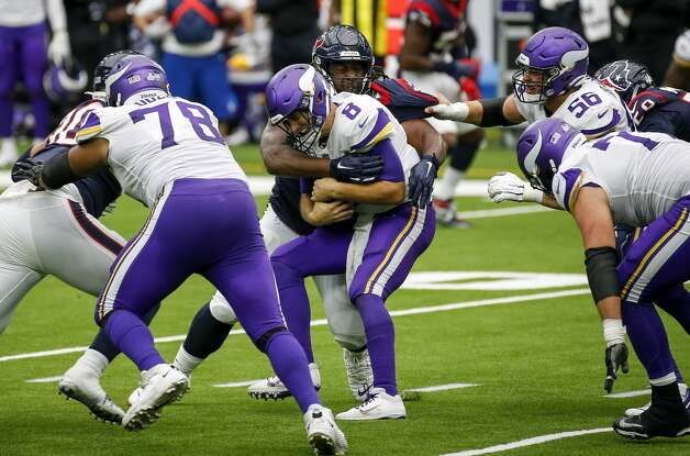 Minnesota Vikings quarterback Kirk Cousins (8) is scaked by Houston Texans defensive end P.J. Hall (96) during the third quarter of an NFL game on Sunday, Oct. 4 2020, at NRG Stadium in Houston. Photo: Jon Shapley/Staff Photographer / © 2020 Houston Chronicle