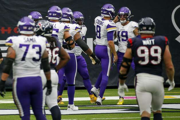 Minnesota Vikings wide receiver Adam Thielen (19) celebrates with quarterback Kirk Cousins (8) after scoring a touchdown during the third quarter of an NFL game on Sunday, Oct. 4 2020, at NRG Stadium in Houston. Photo: Jon Shapley/Staff Photographer / © 2020 Houston Chronicle