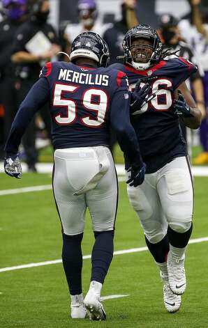 Houston Texans defensive end P.J. Hall (96) celebrates with outside linebacker Whitney Mercilus (59) after he sacked Minnesota Vikings quarterback Kirk Cousins (8) during the third quarter of an NFL game on Sunday, Oct. 4 2020, at NRG Stadium in Houston. Photo: Jon Shapley/Staff Photographer / © 2020 Houston Chronicle