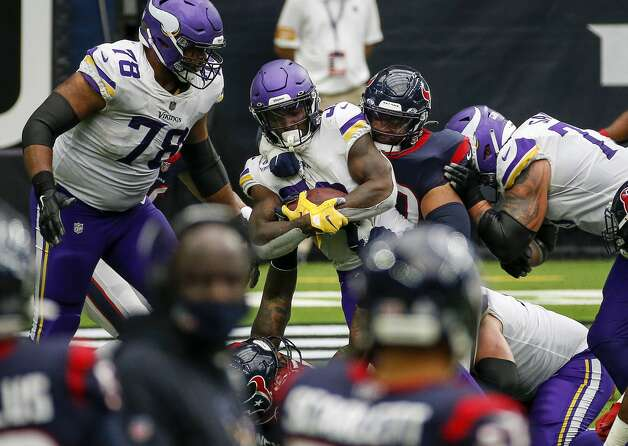Minnesota Vikings running back Dalvin Cook (33) is tackled by Houston Texans defensive tackle Ross Blacklock (90) during the third quarter of an NFL game on Sunday, Oct. 4 2020, at NRG Stadium in Houston. Photo: Jon Shapley/Staff Photographer / © 2020 Houston Chronicle