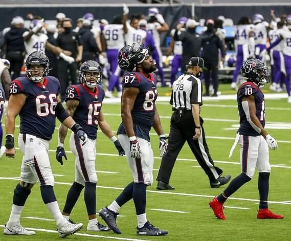 Houston Texans center Nick Martin (66), wide receiver Will Fuller (15), tight end Darren Fells (87) and wide receiver Randall Cobb (18) react after a touchdown was called back during the fourth quarter of an NFL game on Sunday, Oct. 4 2020, at NRG Stadium in Houston. Photo: Jon Shapley/Staff Photographer / © 2020 Houston Chronicle