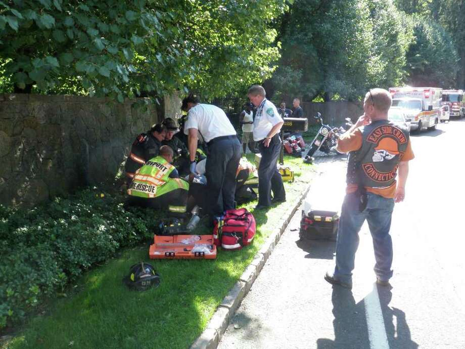Emergency crews tend to an injured motorcyclist who lost control of his bike Saturday afternoon on Beachside Avenue in Westport and crashed into a mailbox. Photo: Contributed Photo / Westport News