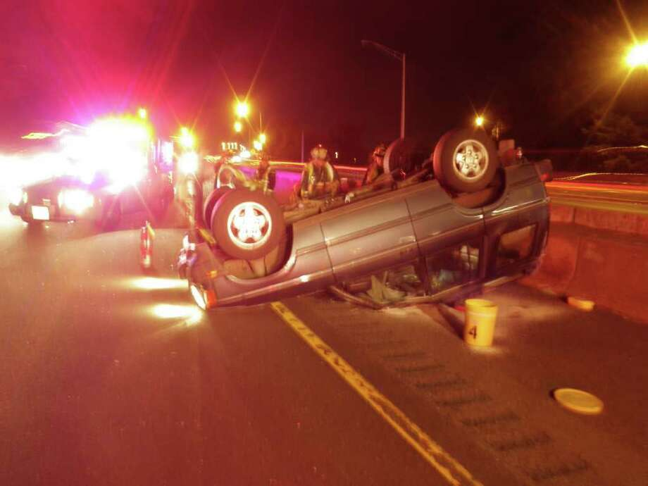 A late-model Land Rover flipped over on Interstate 95 in Westport early Saturday, tying up southbound traffic. Photo: Contributed Photo / Westport News