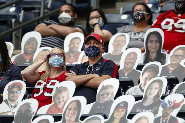 Houston Texans fans sit amongst fan cutouts as they watch the fourth quarter of an NFL football game against the Minnesota Vikings at NRG Stadium on Sunday, Oct. 4, 2020, in Houston. Photo: Brett Coomer/Staff Photographer / © 2020 Houston Chronicle