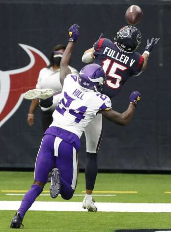 Houston Texans wide receiver Will Fuller (15) leaps up over Minnesota Vikings defensive back Holton Hill (24) in an attempt to make a touchdown grab during the fourth quarter of an NFL football game at NRG Stadium on Sunday, Oct. 4, 2020, in Houston. Originally, the play was ruled a touchdown, but was overturned on replay as Fuller lost control of the ball as he hit the ground. Photo: Brett Coomer/Staff Photographer / © 2020 Houston Chronicle