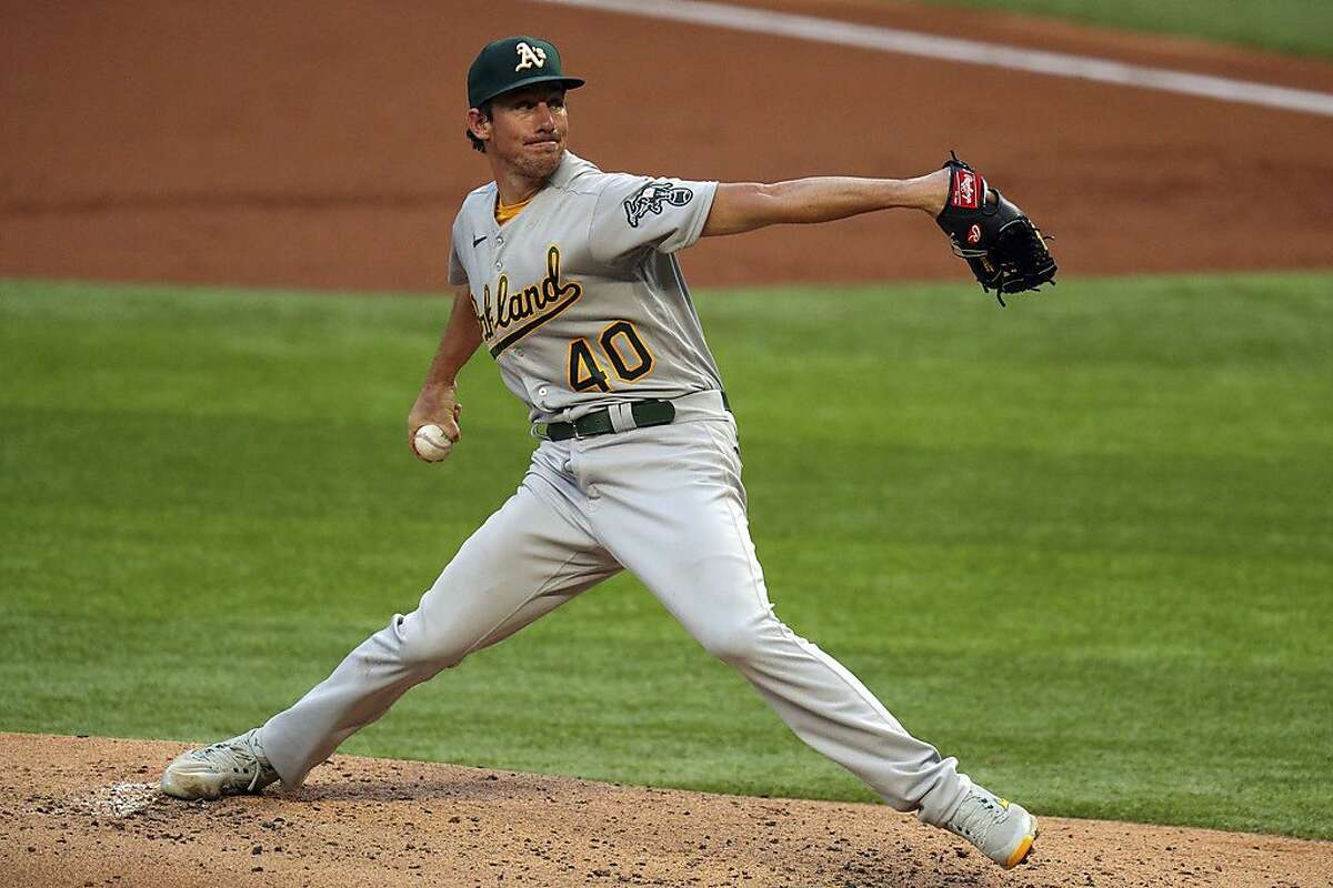 Oakland Athletics starting pitcher Chris Bassitt works the first inning in the second baseball game of a doubleheader against the Texas Rangers on Saturday, Sept. 12, 2020 in Arlington, Texas. (AP Photo/Richard W. Rodriguez)