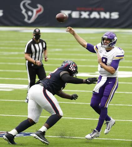 Minnesota Vikings quarterback Kirk Cousins (8) throws a pass over Houston Texans nose tackle Brandon Dunn (92) during the first half of an NFL football game at NRG Stadium on Sunday, Oct. 4, 2020, in Houston. Photo: Brett Coomer/Staff Photographer / © 2020 Houston Chronicle