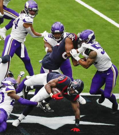 Houston Texans running back David Johnson (31) is stopped by the Minnesota Vikings defense during the first half of an NFL football game at NRG Stadium on Sunday, Oct. 4, 2020, in Houston. Photo: Brett Coomer/Staff Photographer / © 2020 Houston Chronicle