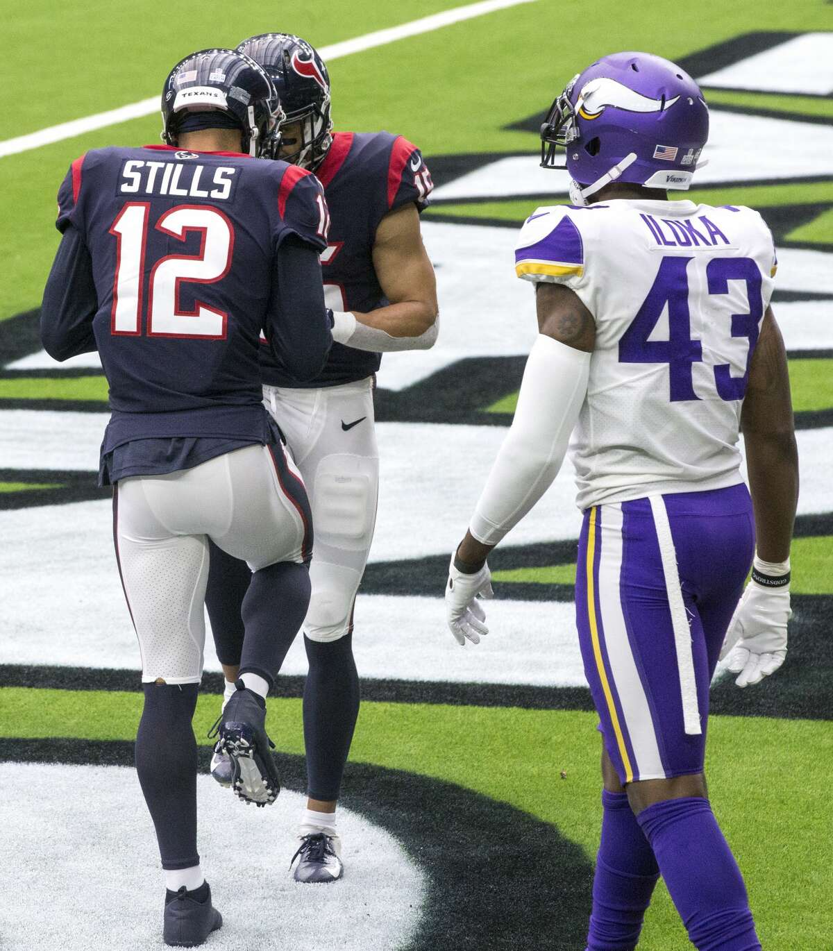 Houston Texans wide receivers Kenny Stills (12) and Will Fuller (15) celebrate Stills' 24-yard touchdown reception during the fourth quarter of an NFL football game at NRG Stadium on Sunday, Oct. 4, 2020, in Houston.