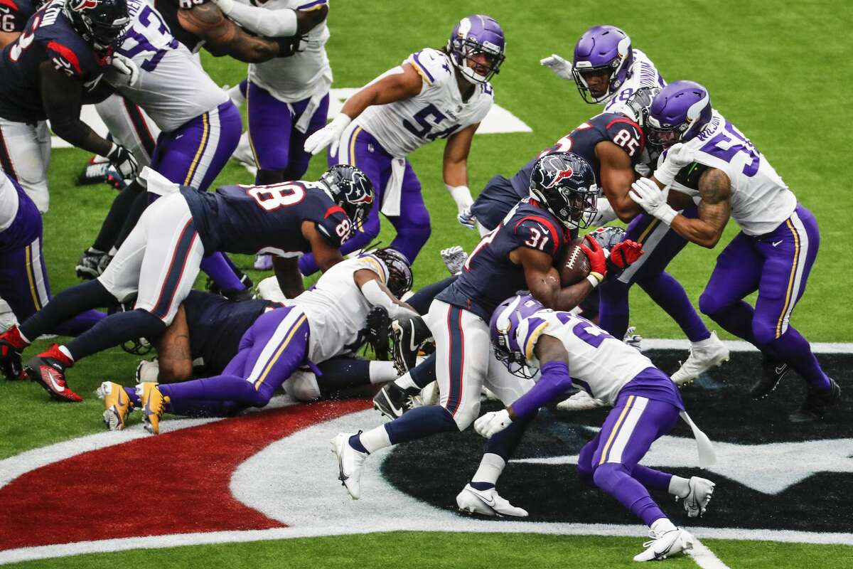 Houston Texans running back David Johnson (31) is stopped by the Minnesota Vikings defense during the first half of an NFL football game at NRG Stadium on Sunday, Oct. 4, 2020, in Houston.