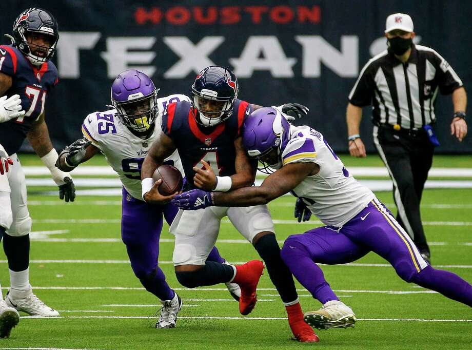 Texans quarterback Deshaun Watson (4) is tackled by Minnesota Vikings defensive end Jalyn Holmes, right, and defensive end Ifeadi Odenigbo, left, during the fourth quarter on Sunday, Oct. 4m 2020, at NRG Stadium in Houston. Photo: Jon Shapley, Houston Chronicle / Staff Photographer / © 2020 Houston Chronicle