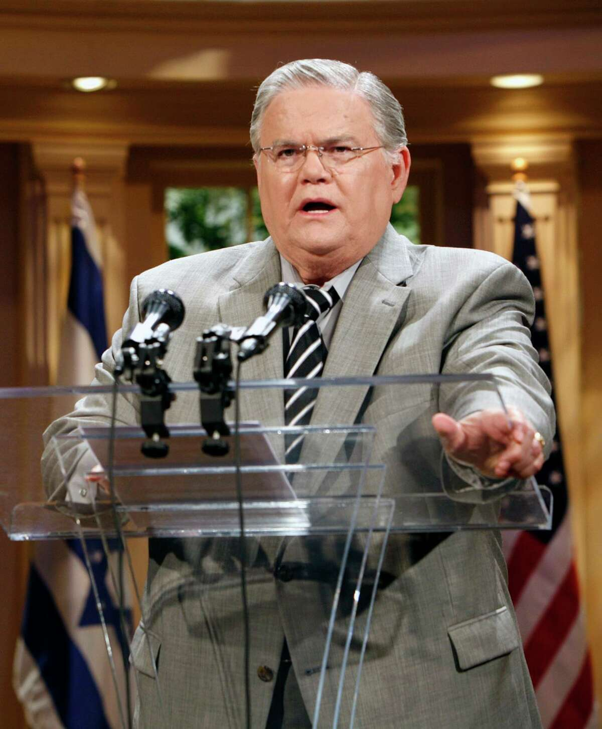 ** FILE ** In this May 23, 2008, file photo the Rev. John Hagee speaks during a news conference at the Cornerstone Church in San Antonio, Texas. Hagee, the inter- nationally known radio/TV evangelist, is recovering after undergoing open heart surgery Thursday, Oct. 2, 2008. (AP Photo /J. Michael Short, File)