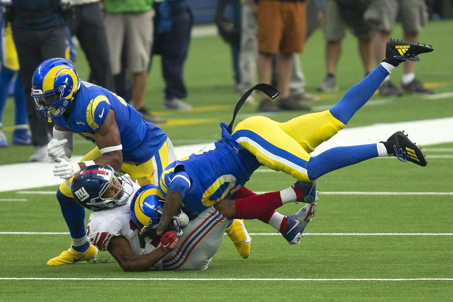Los Angeles Rams cornerback Jalen Ramsey (20), right, tackles New York Giants wide receiver Golden Tate (15) during an NFL football game, Sunday, Oct. 4, 2020, in Inglewood, Calif. (AP Photo/Kyusung Gong) Photo: Kyusung Gong, Associated Press
