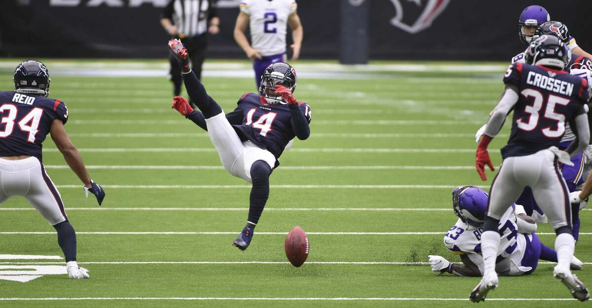 Houston Texans wide receiver DeAndre Carter (14) fumbles on a punt return during the first half of an NFL football game against the Minnesota Vikings, Sunday, Oct. 4, 2020, in Houston. Minnesota recovered the ball. (AP Photo/Eric Christian Smith)