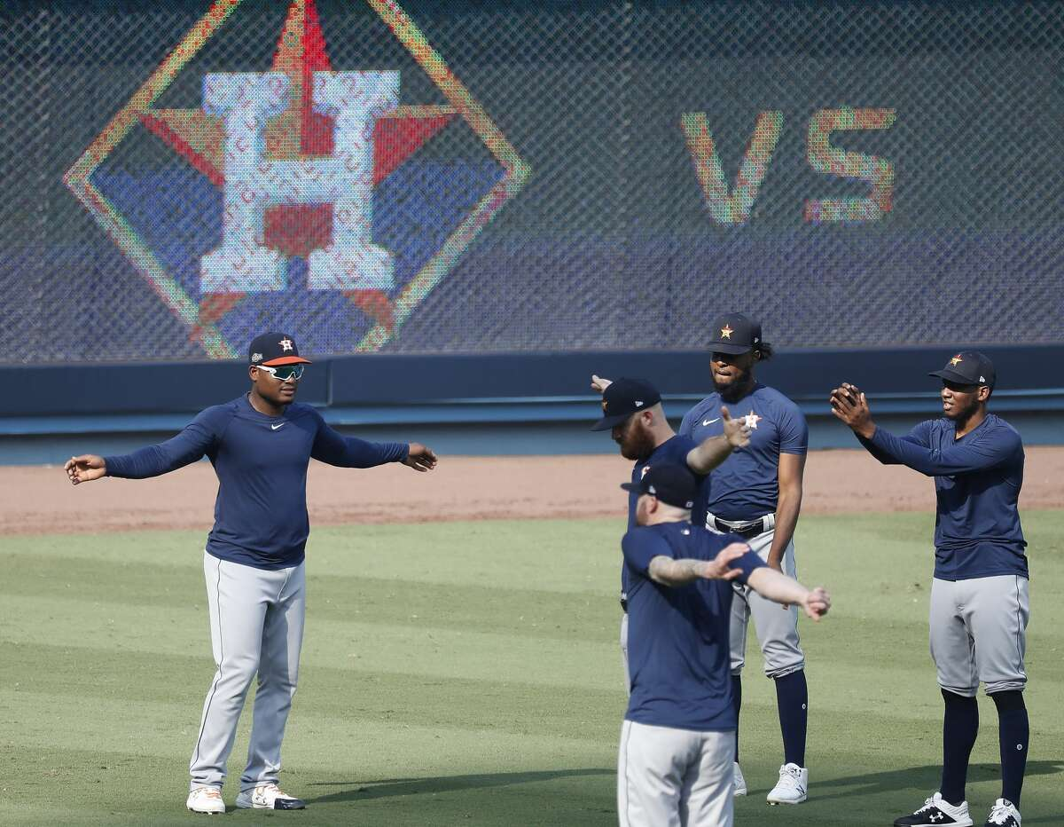 PHOTOS: A look at the Astros' workout at Dodger Stadium on Sunday Houston Astros pitcher Framber Valdez and the other pitchers warm up during batting practice and workouts, Sunday, October 4, 2020, in Los Angeles, as the Astros prepared to take on the Oakland Athletics in Game 1 of the ALDS, Monday, at Dodger Stadium.