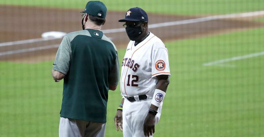 PHOTOS: ALDS workout Houston Astros manager Dusty Baker Jr. and Oakland A's manager Bob Melvin chat before the start of the first inning of game two of a double header during an MLB baseball game at Minute Maid Park, Saturday, August 29, 2020, in Houston. Photo: Karen Warren/Staff Photographer / © 2020 Houston Chronicle