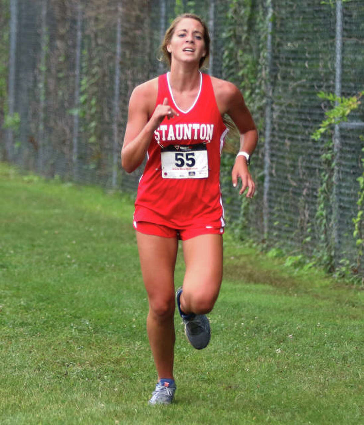 Staunton's Brooke Kinder, shown nearing the finish at the Carlinville Early Meet on Sept. 1, was one of three Bulldogs running in the girls race Saturday at the Southwestern Invite in Piasa.