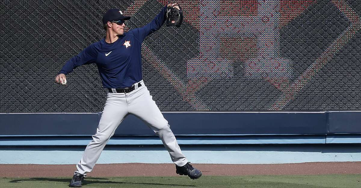 PHOTOS: ALDS workout Houston Astros pitcher Zack Greinke throws the ball in the outfield during batting practice and workouts, Sunday, October 4, 2020, in Los Angeles, as the Astros prepared to take on the Oakland Athletics in Game 1 of the ALDS, Monday, at Dodger Stadium.