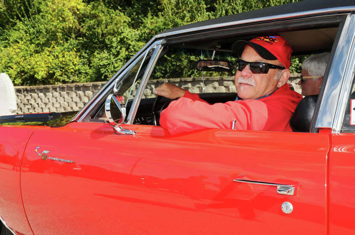 Ed Hamberg, of Godfrey, proudly grips the steering wheel of his 1969 Plymouth Road Runner. He waited 50 years before he finally got his dream car.