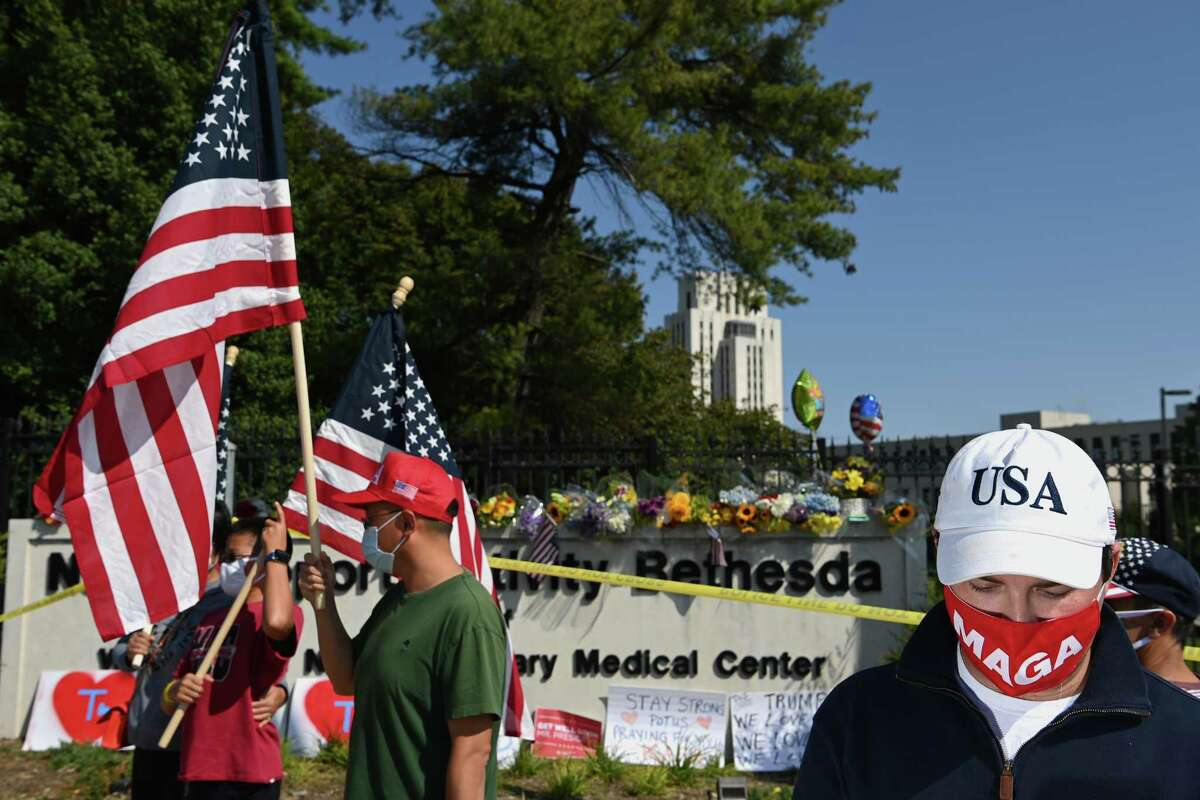 Trump supporters gather outside Walter Reed National Military Medical Center on Sunday, Oct. 4, 2020, in Bethesda, Md. President Donald Trump flew to Walter Reed on Friday to be treated for the novel coronavirus.