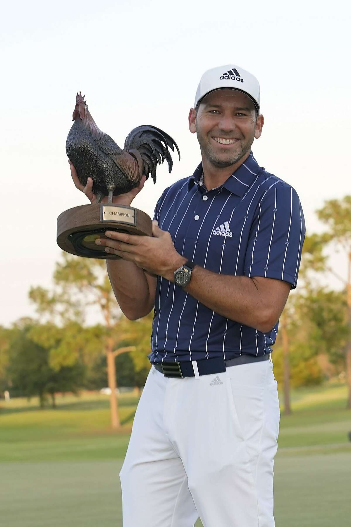 Sergio Garcia holds the unique Sanderson Farms Championship trophy.