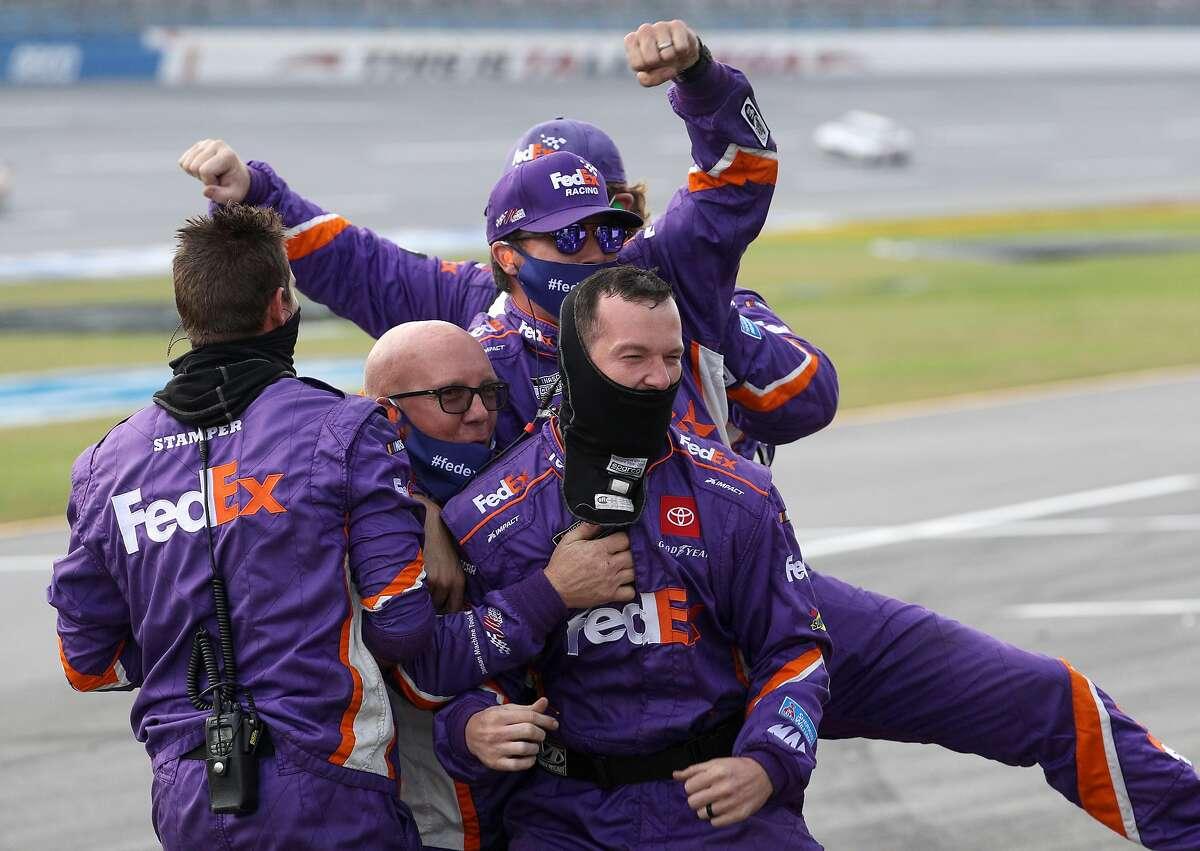 Denny Hamlin's team celebrates winning the NASCAR Cup Series race at Talladega (Ala.) Superspeedway.