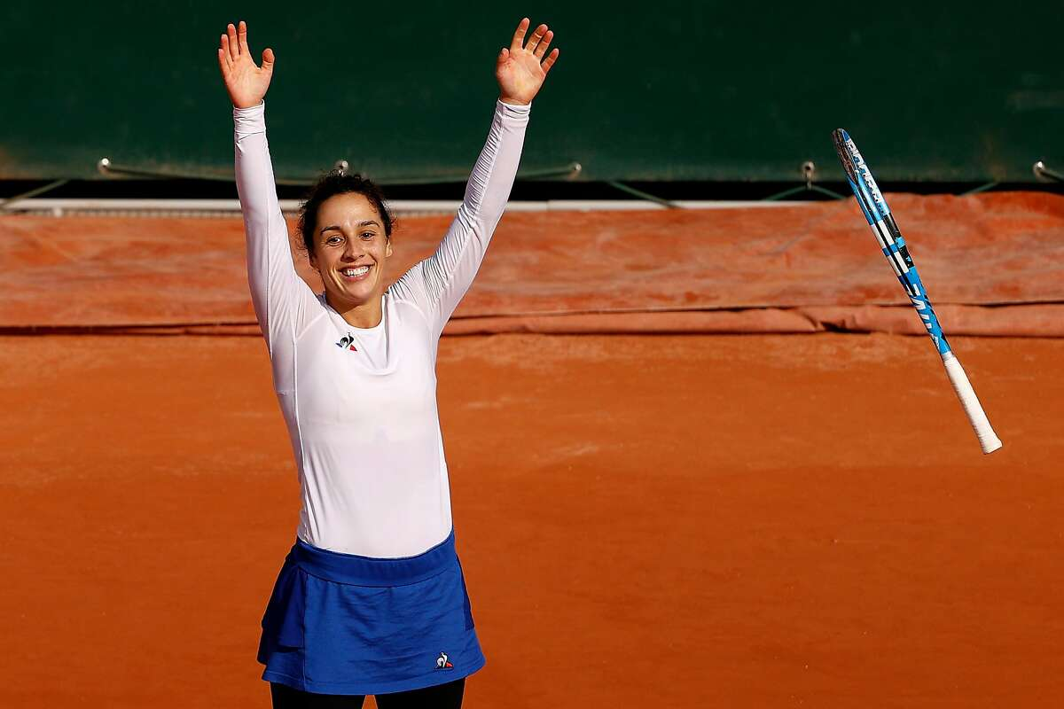 Italian qualifier Martina Trevisan celebrates after her fourth-round win over fifth-seeded Kiki Bertens.