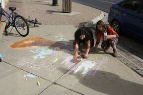 The Bad Axe Area District Library held its first Chalk Fest on October 3, an event open to all ages where participants demonstrated their chalk art skills from 1:30-3:30 pm along Huron Avenue. Cash prizes for the event were from the library's Lynda Pietscher memorial fund, which funds many art programs for kids.