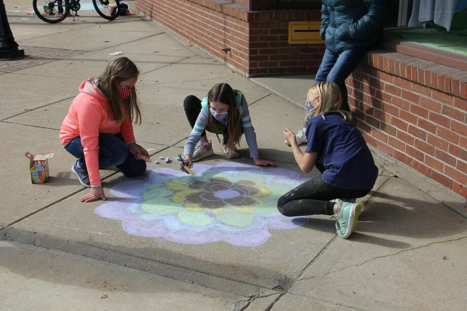 The Bad Axe Area District Library held its first Chalk Fest on October 3, an event open to all ages where participants demonstrated their chalk art skills from 1:30-3:30 pm along Huron Avenue. Cash prizes for the event were from the library's Lynda Pietscher memorial fund, which funds many art programs for kids. Photo: Paige Withey