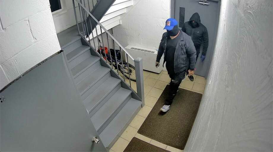 Police have released security footage of two men they say burglarized a South Norwalk apartment building early Friday morning. Photo: Screengrab From Video