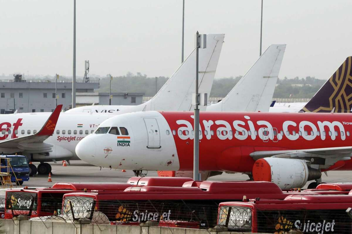 Aircraft operated by AirAsia stand at Indira Gandhi International Airport in New Delhi, India, on June 28, 2020.
