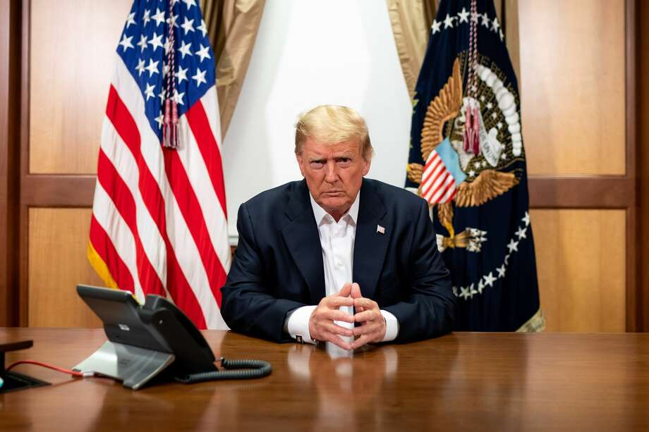 BETHESDA, MD - OCTOBER 04: In this handout provided by The White House, President Donald Trump participates in a phone call with Vice President Mike Pence, Secretary of State Mike Pompeo, and Chairman of the Joint Chiefs of Staff Gen. Mark Milley in his conference room at Walter Reed National Military Medical Center on October 4, 2020 in Bethesda, Maryland. Chief of Staff Mark Meadows (not pictured) is also present in the room on the call. (Photo by Tia Dufour/The White House via Getty Images) Photo: The White House/Getty Images / 2020  White House