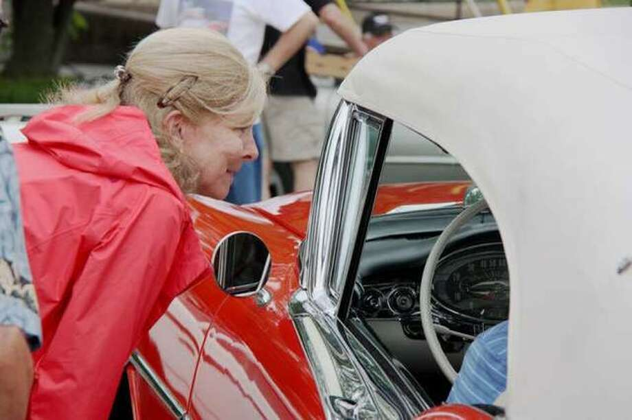 An attendee enjoys the sights and sounds at the 2019 Edwardsville Route 66 Festival last year. The event was canceled this year due to the pandemic. Now, car enthusiasts can see hundreds of antique, muscle and exotic cars during the inaugural Kicks on 66 Ultra Car Show & Cruise on Saturday, Oct. 17. Photo: Charles Bolinger | Intelligencer File Photo