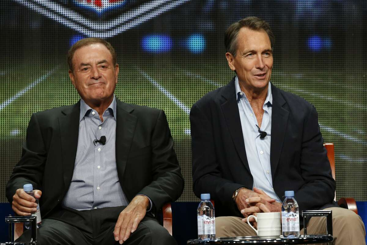 Al Michaels and Cris Collinsworth at NBCUniversal's Press Tour in August 2015. The duo wore masks for Sunday's 49ers-Eagles game.