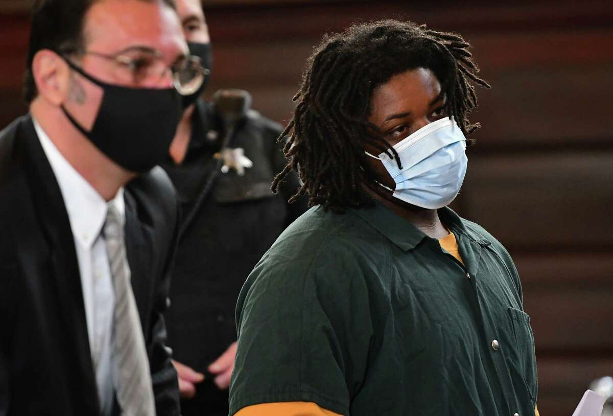 Jahquay Brown, right, stands next to Assistant Public Defendant Greg Cholakis as he is arraigned for second-degree murder in the killing of 11-year-old Ayshawn Davis at the Rensselaer County Court House on Monday, Oct. 5, 2020 in Troy, N.Y. (Lori Van Buren/Times Union)