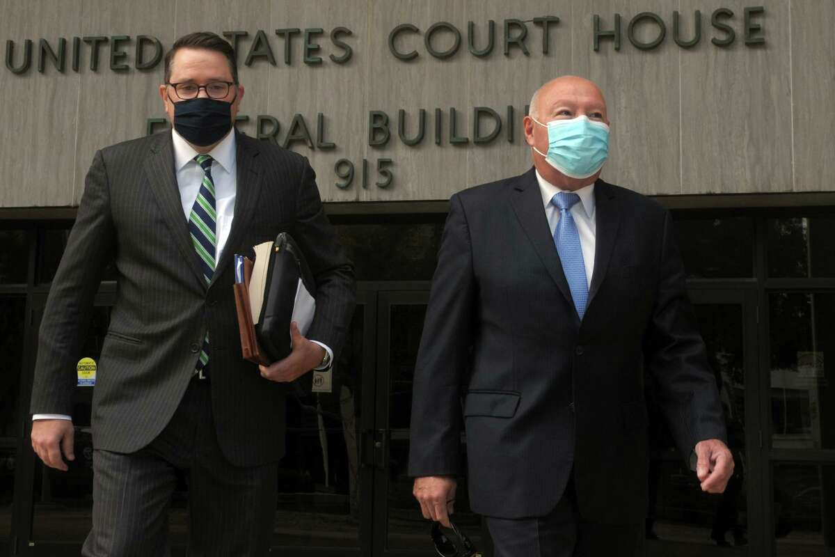 Former Police Chief Armando Perez, right, leaves the Federal Courthouse in Bridgeport, Conn. Oct. 5, 2020. Perez pleading guilty Monday to conspiring to rig the examination process that led to his appointment as police chief and then lying to the FBI about it. Perez is seen here with his attorney, Robert Frost.