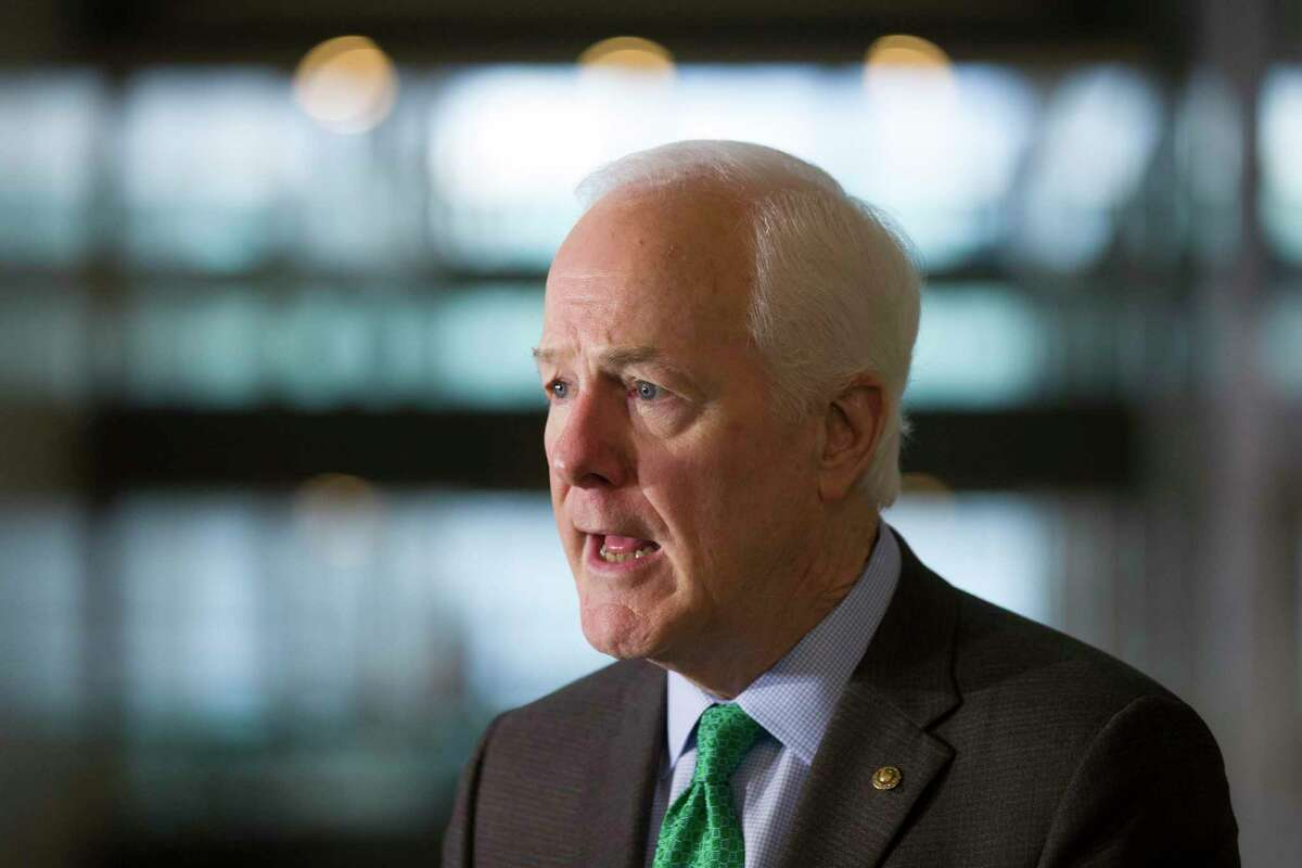 Sen. John Cornyn, R-Texas, speaks with the media after a meeting with Attorney General nominee William Barr, on Capitol Hill, Wednesday, Jan. 9, 2019 in Washington. (AP Photo/Alex Brandon)