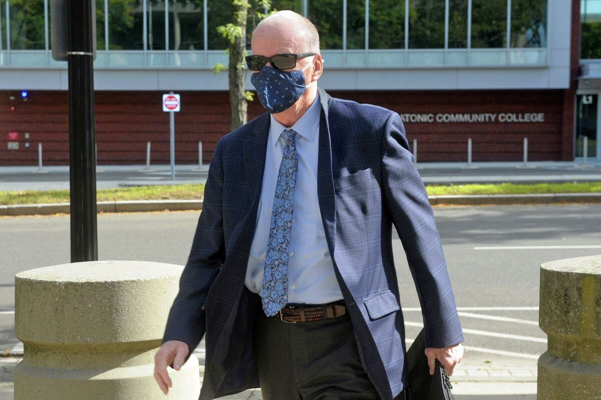 Former City of Bridgeport Personnel Director David Dunn arrives at the Federal Courthouse in Bridgeport, Conn. Oct. 5, 2020. Dunn pleading guilty Monday to conspiring to rig the examination process that led to his appointment as police chief and then lying to the FBI about it.