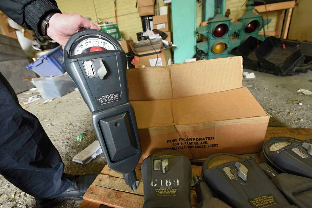 One of the many old coin-fed street parking meters which will be auctioned off is held up in a bay at the Troy Department of Public Works garage on Monday, Oct. 5, 2020 in Troy, N.Y. (Lori Van Buren/Times Union)