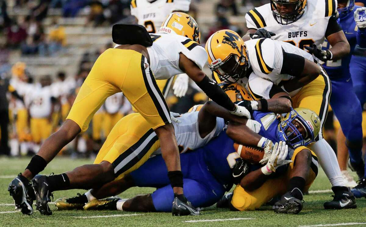 Elkins Knights running back Bryce Bradley (8) runs the ball against the Fort Bend Marshall defense during the first half of the game at Kenneth Hall Stadium on Thursday, Oct. 1, 2020, in Missouri City , Texas.