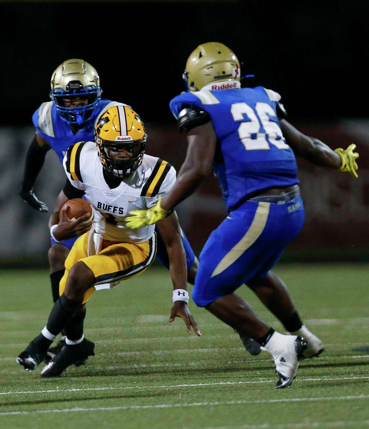 Fort Bend Marshall quarterback Roland Harvey (1) scrambles out of the pocket against the Elkins Knights defense during the second half of the game at Kenneth Hall Stadium Thursday, Oct. 1, 2020, in Missouri City , Texas.