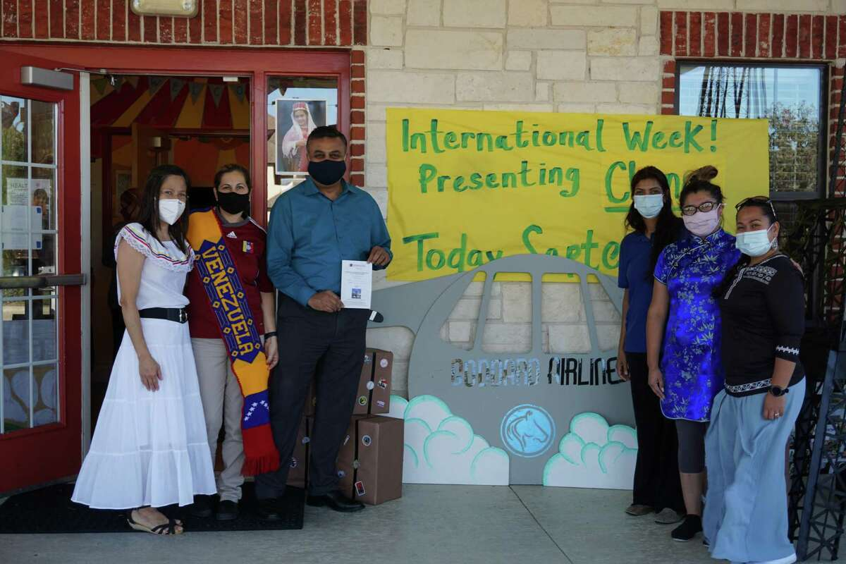 Staff members at The Goddard School of Katy pose at the school's annual Around the Wonders of the World festival on Tuesday, Sept. 29. The festival celebrated different places and cultures from around the world and was adapted to serve the school's community amid the COVID-19 pandemic.