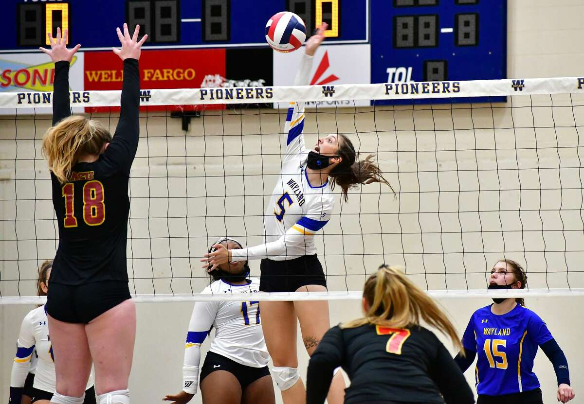 Wayland Baptist's Kellie Kozak attempts to hit the ball past Arizoan Christian defender Tristan Barta during their non-conference volleyball match on Oct. 3, 2020 in the Hutcherson Center.