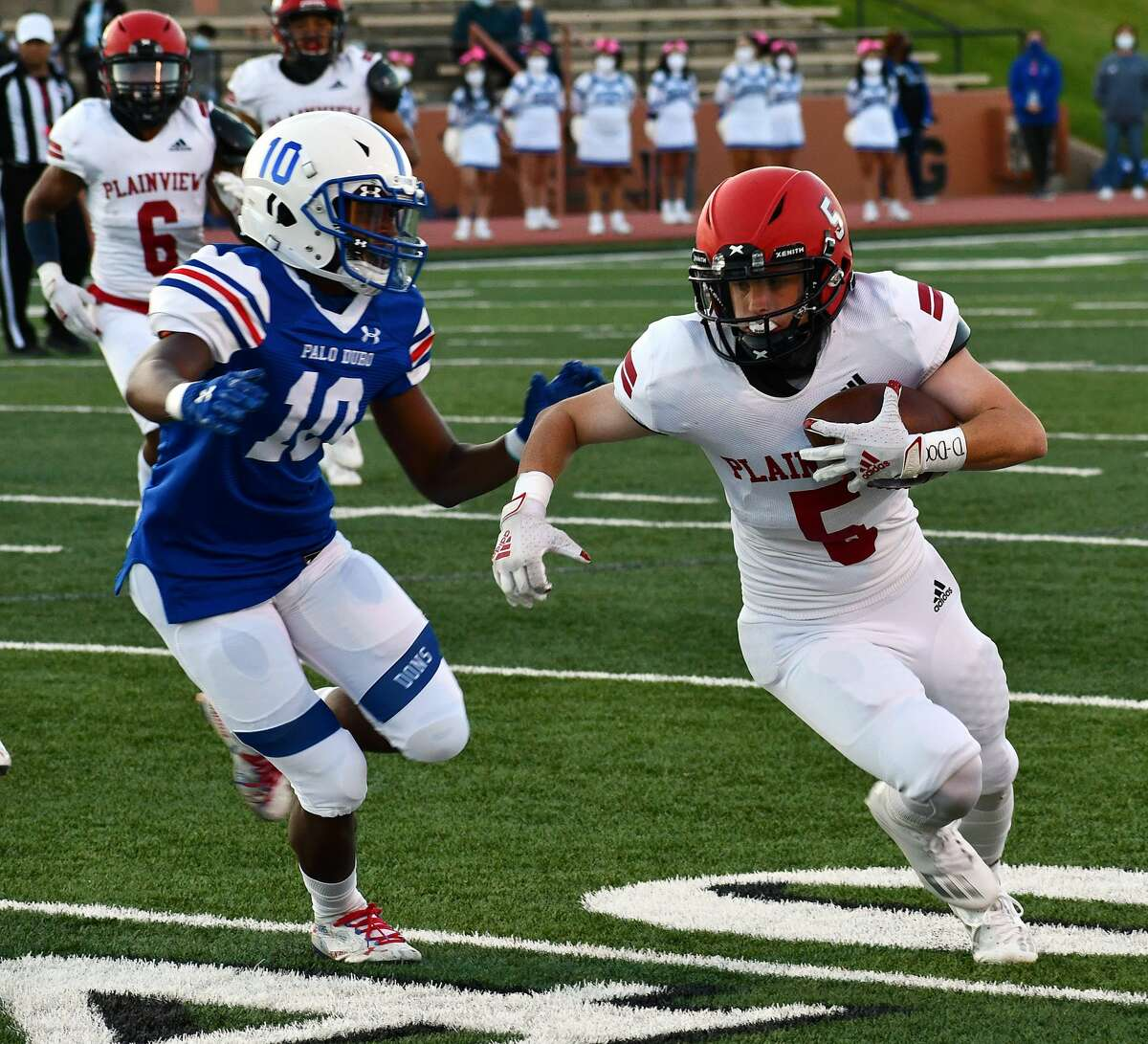 Austin Hauk takes one of his 12 receptions up the field against Palo Duro defender Antwon Lockett during their non-district high school football game on Oct. 1, 2020 in Dick Bivins Stadium in Amarillo.