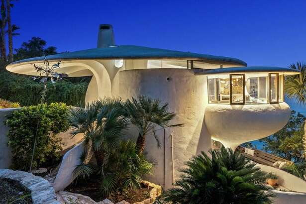 """Yes, if only the curvilinear, sculptural walls of this home called """"The Sand Dollar Home"""" or """"Mushroom Home"""" could talk. An iconic piece of architecture that's shaped in the form of mushroom is now on the market near Austin, Texas for $2.2 million, according to the listing on Grossman & Jones Group. In the spirit of the """"Keeping Austin Weird,"""" this Lakeway home perfectly fulfills that vibe and was most recently featured on the Austin Weird Homes Tour. You're unlikely to find anything as otherworldly and unusual on the market in Texas as this lakeside abode, if you have a cool $2 million at your disposal."""